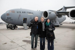 Cinematographer Jaka Vinsek, Director Carolyn Jones and Producer Lisa Frank in front of a military aircraft at Ramstein U.S. Air Base in Germany.