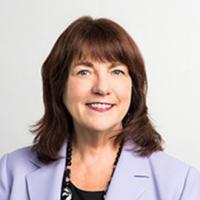 Susan Reinhard in purple jacket