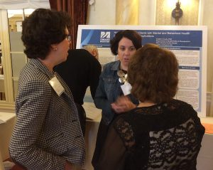 Nurses discuss poster session at healthcare workforce summit