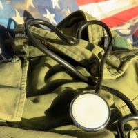 Stethoscope with army fatigues and an American flag