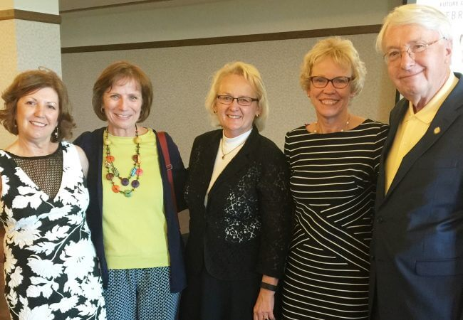 Victoria Vinton (far left) celebrates the Nebraska Action Coalition's fifth birthday during the RWJF Culture of Health Summit in Omaha in June 2016. Also pictured: Campaign Director Sue Hassmiller, Nebraska Action Coalition board members Cyndi McCullough and Deb Welk, and Nebraska Sen. Merv Riepe.