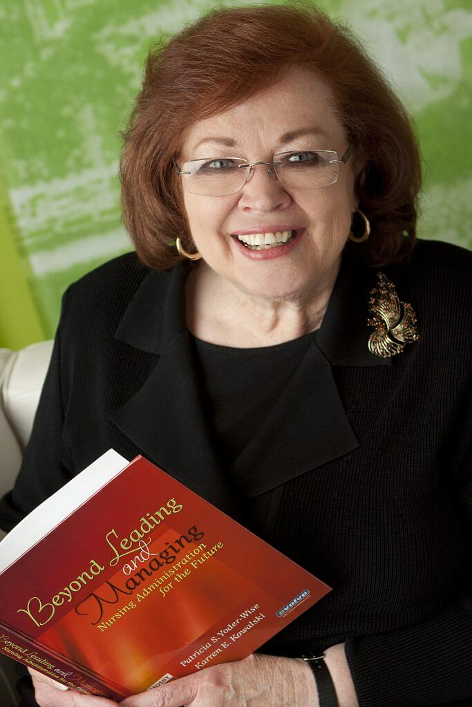 Karren Kowalski holds a book she co-authored