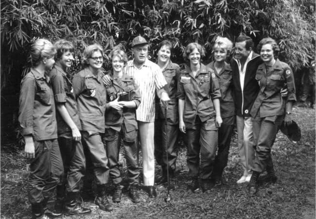 Bob Hope and Vic Damone stand with nurses from the 3rd Surgical Hospital