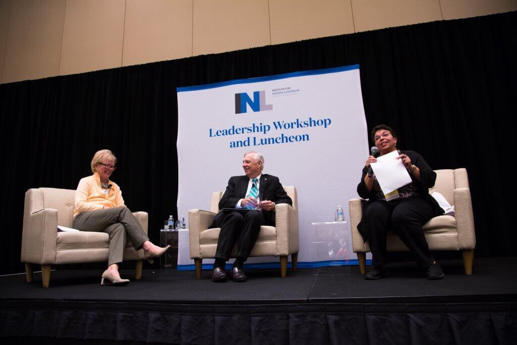 Three panelists on stage