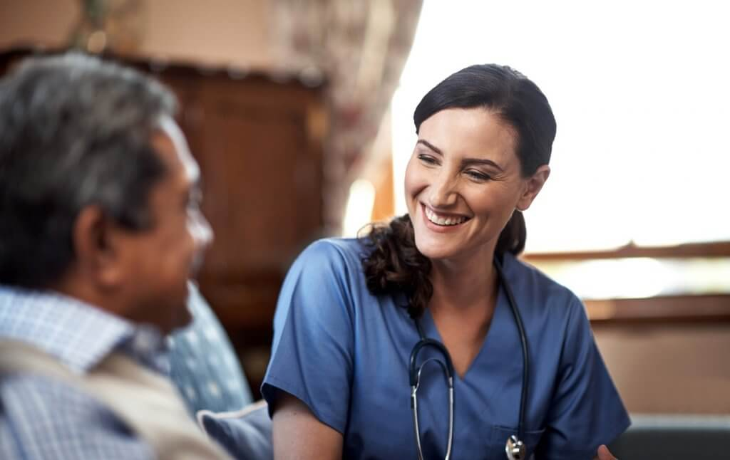 Image of nurse and patient. One of the gifts nurses give is the gift of listening.