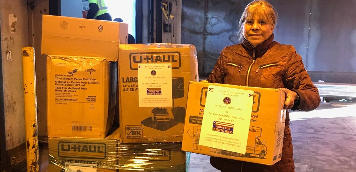 Humanitarian Gina Miranda-Diaz with packages sent to Puerto Rico