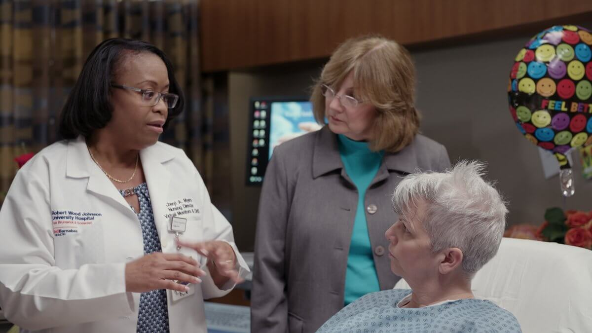 Nurse explains to caregiver and patient what it needed to be done in order to get the patient healthy.