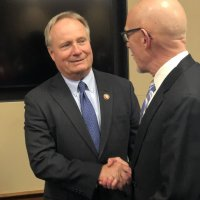 Congressman David Joyce (OH), co-chair of the House nursing caucus, left, greets RWJF's Paul Kuehnert