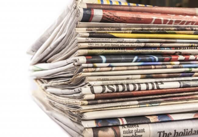 Pile of newspapers sharing your nursing story