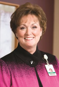 Headshot of Judy Boerger, MSN, MBA, who throught of the emeritus nurse.