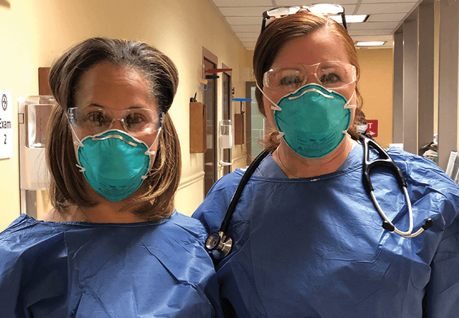Krystal Howard, DNP, APRN, FNP-BC and Sophia L. Thomas DNP, APRN, FNP-BC, PPCNP-BC, FNAP, FAANP on site at DePaul Community Health Center in PPE during the COVID-19 pandemic