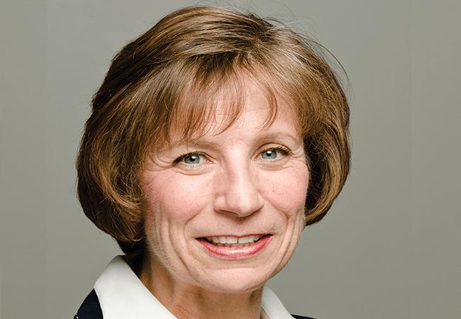 headshot of Sue Hassmiller